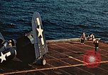 Image of Navy fighter aircraft landing on USS Essex Pacific Theater, 1945, second 62 stock footage video 65675040813