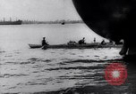 Image of Pacific Islanders in dugout canoes Pacific Theater, 1942, second 30 stock footage video 65675040839