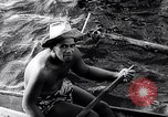 Image of Pacific Islanders in dugout canoes Pacific Theater, 1942, second 32 stock footage video 65675040839
