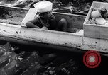 Image of Pacific Islanders in dugout canoes Pacific Theater, 1942, second 33 stock footage video 65675040839