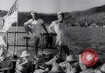 Image of Pacific Islanders in dugout canoes Pacific Theater, 1942, second 37 stock footage video 65675040839