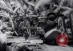Image of Pacific Islanders in dugout canoes Pacific Theater, 1942, second 57 stock footage video 65675040839