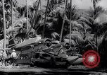 Image of Pacific Islanders in dugout canoes Pacific Theater, 1942, second 58 stock footage video 65675040839