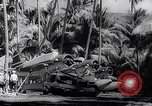 Image of Pacific Islanders in dugout canoes Pacific Theater, 1942, second 59 stock footage video 65675040839