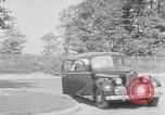 Image of car-pooling Middle River Maryland USA, 1942, second 13 stock footage video 65675040912