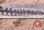 Image of Borax transport by 20 mule teams Death Valley California USA, 1894, second 39 stock footage video 65675040984