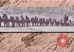 Image of Borax transport by 20 mule teams Death Valley California USA, 1894, second 43 stock footage video 65675040984