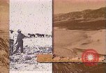 Image of Borax transport by 20 mule teams Death Valley California USA, 1894, second 58 stock footage video 65675040984