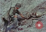 Image of dead Japanese soldiers Eniwetok Atoll Marshall Islands, 1944, second 51 stock footage video 65675041028