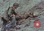 Image of dead Japanese soldiers Eniwetok Atoll Marshall Islands, 1944, second 52 stock footage video 65675041028