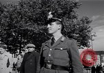 Image of German police officer directs traffic Berlin Germany, 1952, second 21 stock footage video 65675041180
