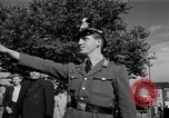 Image of German police officer directs traffic Berlin Germany, 1952, second 26 stock footage video 65675041180