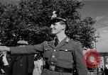 Image of German police officer directs traffic Berlin Germany, 1952, second 27 stock footage video 65675041180