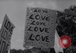 Image of Hippies at a demonstration London England United Kingdom, 1967, second 34 stock footage video 65675041331
