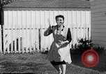 Image of Louella Gallagher knife throwing stunt Austin Texas USA, 1950, second 59 stock footage video 65675041468