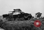 Image of Japanese tank crosses ditch India, 1944, second 16 stock footage video 65675041509