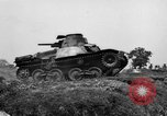 Image of Japanese tank crosses ditch India, 1944, second 18 stock footage video 65675041509