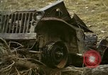 Image of Wrecked U.S. military trucks after Hoengsong massacre Hoengsong Korea, 1951, second 8 stock footage video 65675041618