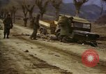 Image of Wrecked U.S. military trucks after Hoengsong massacre Hoengsong Korea, 1951, second 28 stock footage video 65675041618