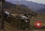 Image of Wrecked U.S. military trucks after Hoengsong massacre Hoengsong Korea, 1951, second 55 stock footage video 65675041618