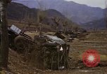 Image of Wrecked U.S. military trucks after Hoengsong massacre Hoengsong Korea, 1951, second 56 stock footage video 65675041618
