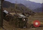 Image of Wrecked U.S. military trucks after Hoengsong massacre Hoengsong Korea, 1951, second 58 stock footage video 65675041618