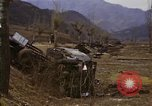 Image of Wrecked U.S. military trucks after Hoengsong massacre Hoengsong Korea, 1951, second 59 stock footage video 65675041618
