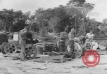Image of B-29 lifted at North Field Guam, 1945, second 11 stock footage video 65675041657