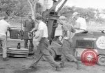 Image of B-29 lifted at North Field Guam, 1945, second 24 stock footage video 65675041657