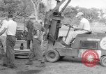 Image of B-29 lifted at North Field Guam, 1945, second 25 stock footage video 65675041657