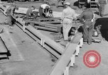 Image of B-29 lifted at North Field Guam, 1945, second 30 stock footage video 65675041657