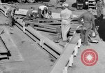 Image of B-29 lifted at North Field Guam, 1945, second 31 stock footage video 65675041657