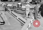Image of B-29 lifted at North Field Guam, 1945, second 32 stock footage video 65675041657