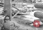 Image of B-29 lifted at North Field Guam, 1945, second 33 stock footage video 65675041657