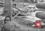 Image of B-29 lifted at North Field Guam, 1945, second 35 stock footage video 65675041657
