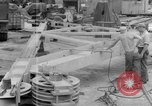 Image of B-29 lifted at North Field Guam, 1945, second 36 stock footage video 65675041657