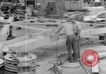 Image of B-29 lifted at North Field Guam, 1945, second 39 stock footage video 65675041657