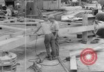 Image of B-29 lifted at North Field Guam, 1945, second 41 stock footage video 65675041657