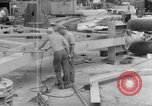 Image of B-29 lifted at North Field Guam, 1945, second 42 stock footage video 65675041657