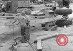 Image of B-29 lifted at North Field Guam, 1945, second 43 stock footage video 65675041657