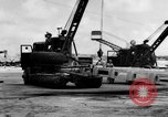 Image of B-29 lifted at North Field Guam, 1945, second 44 stock footage video 65675041657
