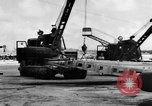 Image of B-29 lifted at North Field Guam, 1945, second 46 stock footage video 65675041657