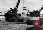 Image of B-29 lifted at North Field Guam, 1945, second 47 stock footage video 65675041657
