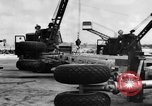 Image of B-29 lifted at North Field Guam, 1945, second 48 stock footage video 65675041657