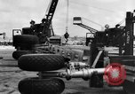Image of B-29 lifted at North Field Guam, 1945, second 49 stock footage video 65675041657