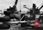 Image of B-29 lifted at North Field Guam, 1945, second 50 stock footage video 65675041657