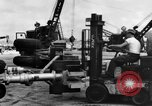 Image of B-29 lifted at North Field Guam, 1945, second 51 stock footage video 65675041657