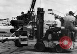 Image of B-29 lifted at North Field Guam, 1945, second 52 stock footage video 65675041657