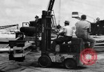 Image of B-29 lifted at North Field Guam, 1945, second 53 stock footage video 65675041657
