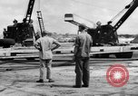 Image of B-29 lifted at North Field Guam, 1945, second 54 stock footage video 65675041657